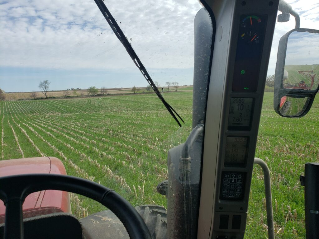LASA member Jason Rowe planting soybeans into rye that was flown on into standing corn